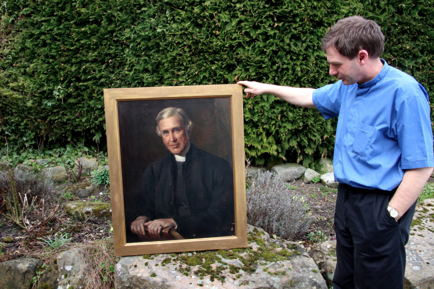 Mark Barker holding the portrait