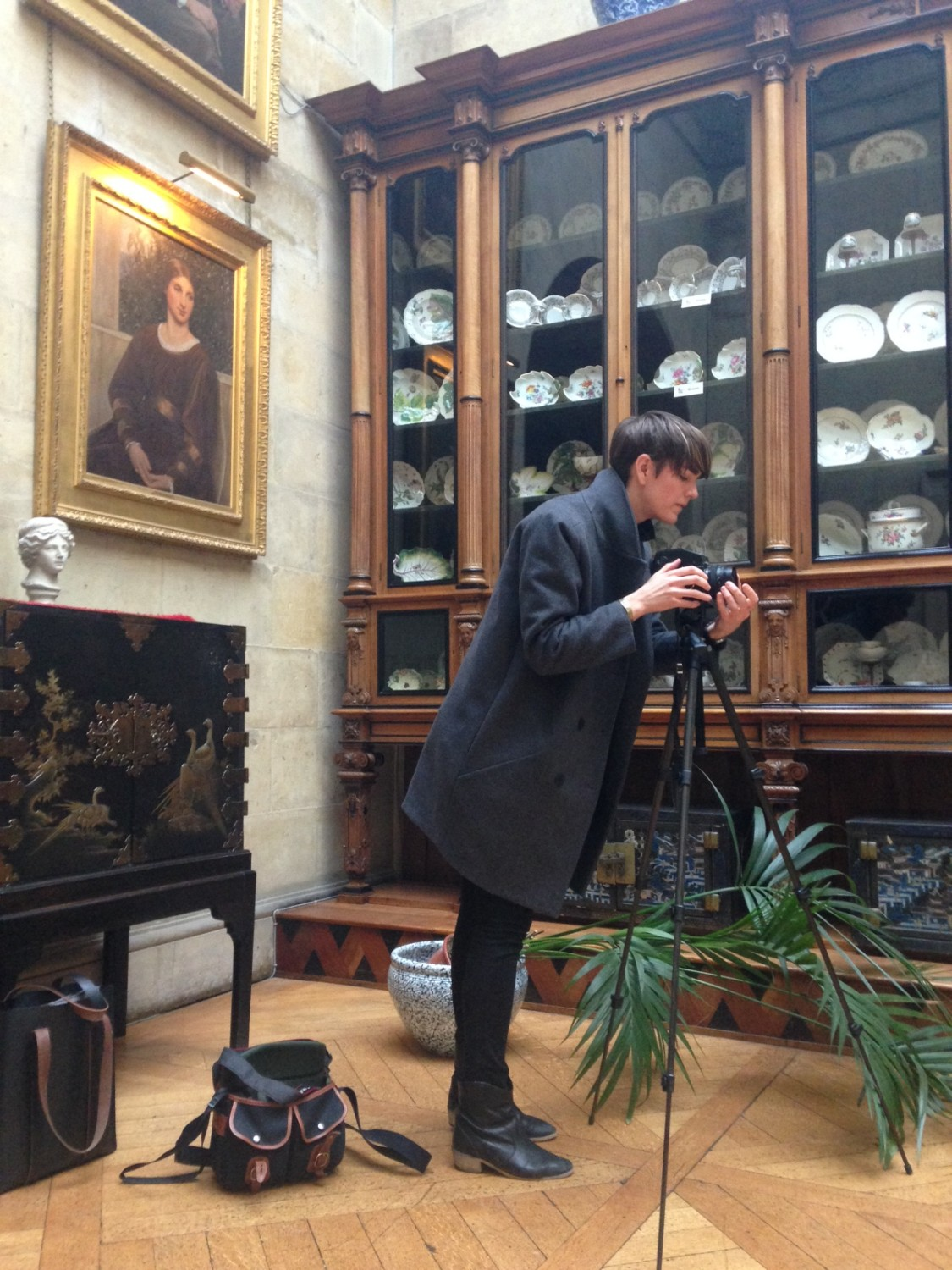 Elly Clarke taking Mr Howard's portrait in the Hall at Castle Howard. Photo: Simon Harper